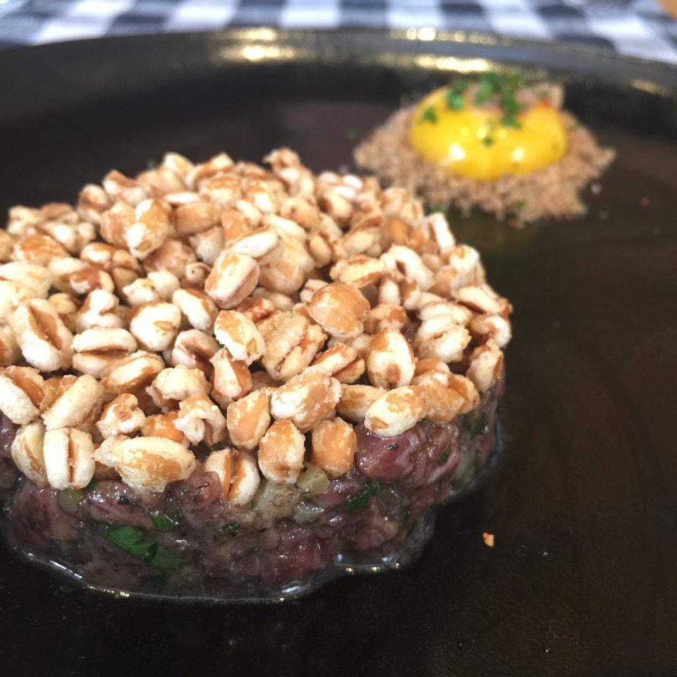 Beef Tartare, black trumpet mushroom, puffed farro, anchovy + egg yolk on #foodmento http://foodmento.com/dish/25255