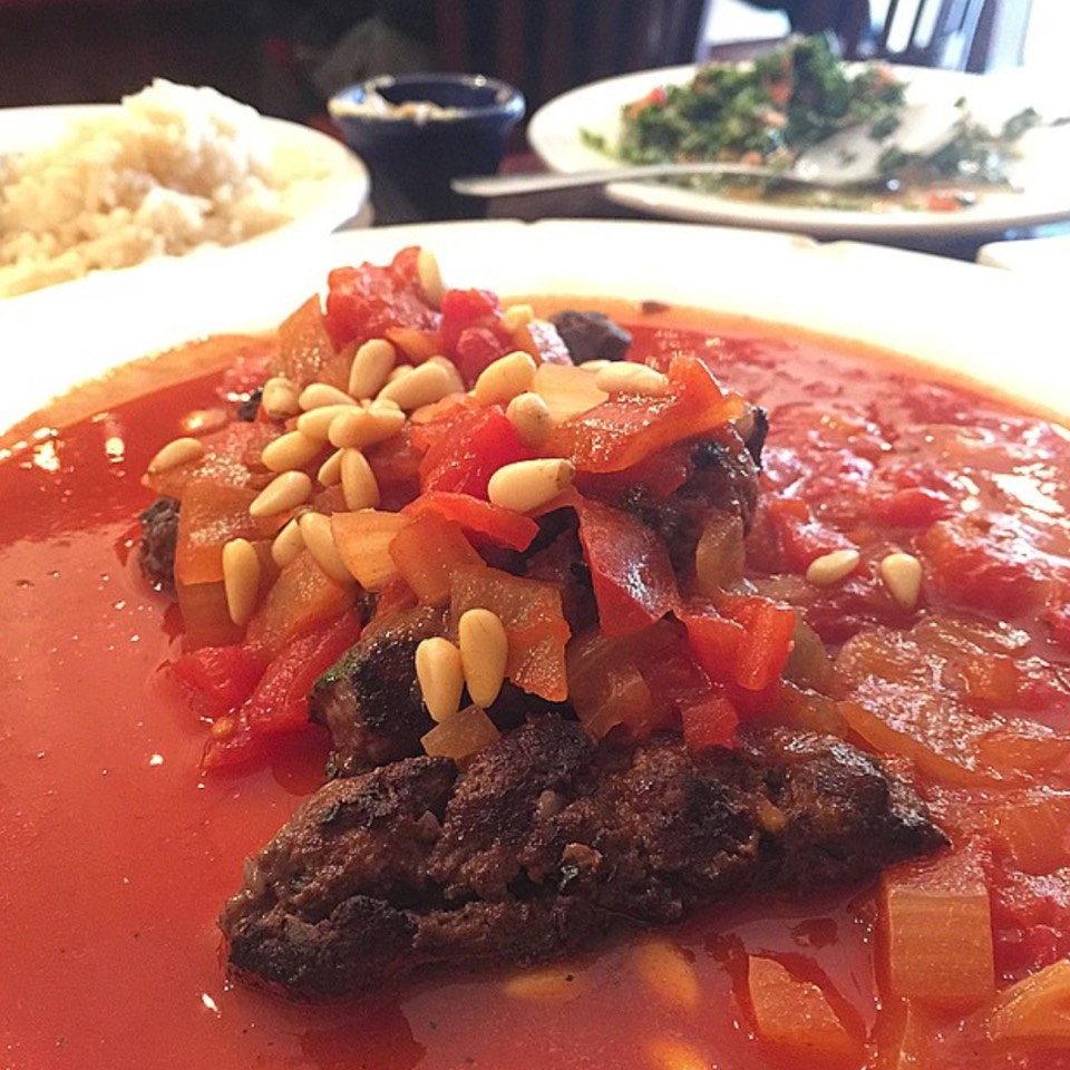Halabi chopped meat with parsley, onion, pine nuts, tomato sauce, served with rice and salad at Gazala's Place on #foodmento http://foodmento.com/place/5724