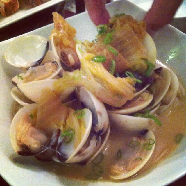 Steamed Clams, fig broth, kim chee, pickled wakame, spring onions at Morsels on #foodmento http://foodmento.com/place/1115